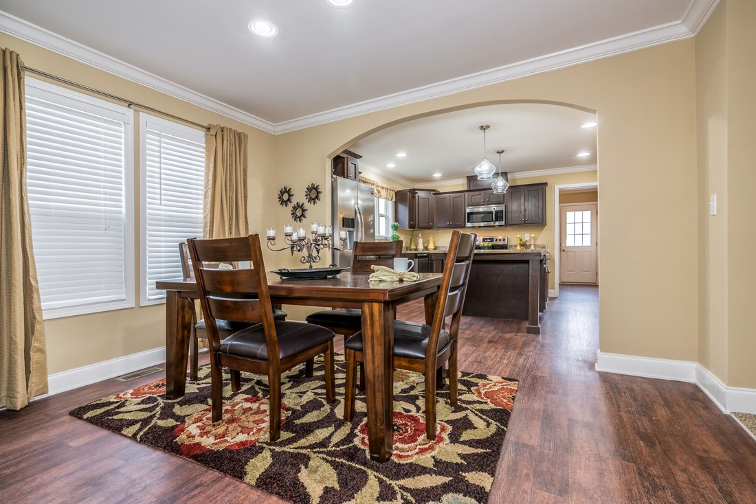 The 1779 LEGACY Dining Area. This Manufactured Mobile Home features 3 bedrooms and 2 baths.